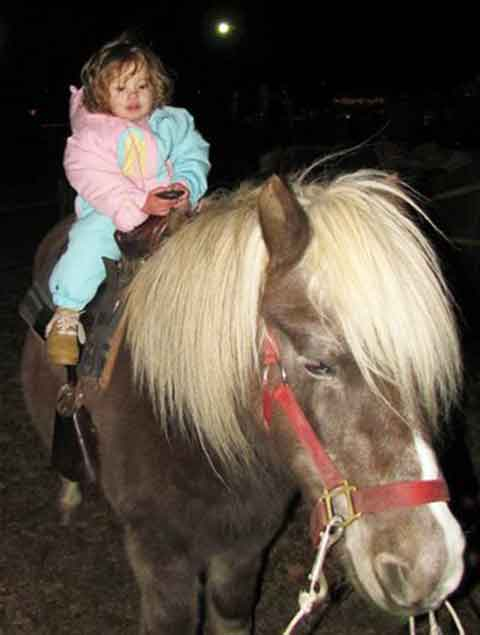 Little Girl on a Pony Ride at Pettit Creek Farms